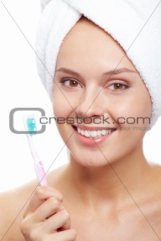 Female with toothbrush