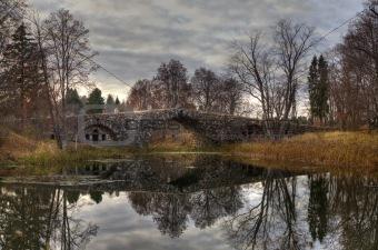 Arched boulder bridge