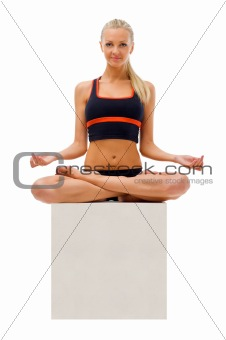 Beautiful woman is doing yoga exercises. Lotus pose
