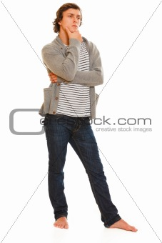 Full length portrait of thoughtful young man