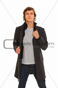 Portrait of young man in winter coat