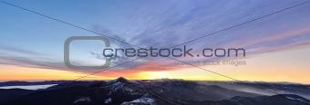 First snow on the morning mountain ridges. Sunrise.