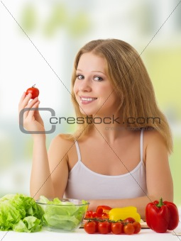 beautiful  girl with vegetables in the kitchen