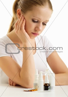 Young woman having flu takes pills