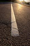sunrise light on asphalt road