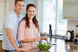 Couple with salad in the kitchen