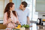 Couple preparing salad