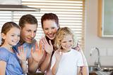 Family waving with their hands