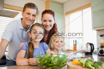 Family standing behind the kitchen counter