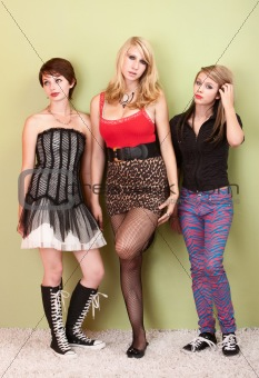 Three attractive teen punk girls looking bored