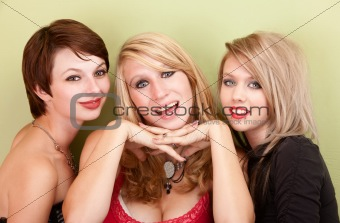 Three attractive teen girls smile for a portrait