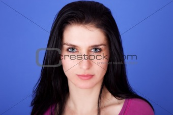beautiful woman isolated on blue background, studio shot.