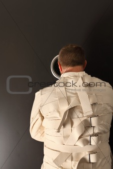 Waiting in a straitjacket