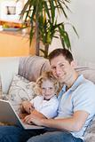 Father and son together with laptop