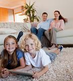 Children on the carpet using tablet
