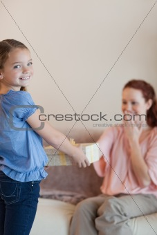 Little girl giving her mother a present