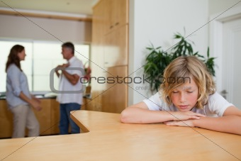 Sad boy has to listen to fighting parents