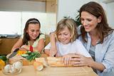 Woman making sandwiches with her children