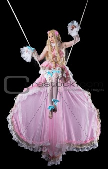 Pretty girl in fary-tale doll costume fly in dark