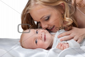 Beauty blond woman kiss a baby