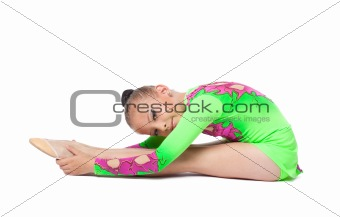 young gymnast in green sit on isolated