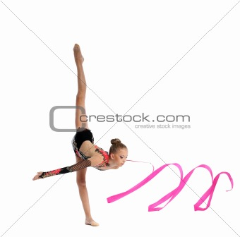 teenager doing gymnastics split with ribbon