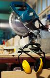 plywood circular saw and protective earphones
