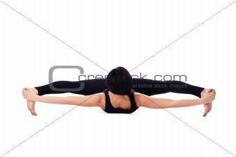 woman sit in yoga asana - doing split