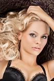 sensual girl with blond curly hair