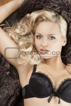sensual girl laying on fur