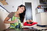 gorgeous woman with a cake seen from inside of a stove 