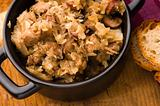 traditional polish sauerkraut (bigos) with mushrooms and plums for christmas 