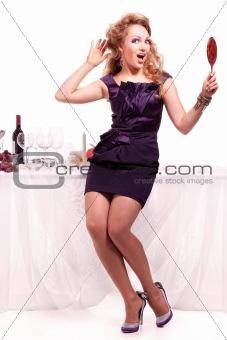Portrait of beutiful woman standing nea table