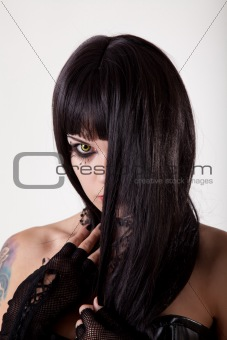 Young gothic woman with yellow eyes