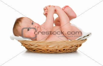 Beautiful baby boy lies in pad and plays with own feet
