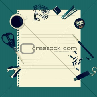 Office table with stationery accessories and empty paper for you