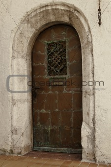 Old oxidated copper entrance door with verdigris