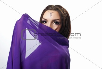 Beauty woman close face by purple cloth