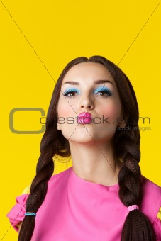 Beauty girl with funny make-up in doll costume