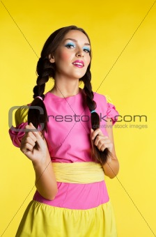 Young woman with funny make-up in doll costume