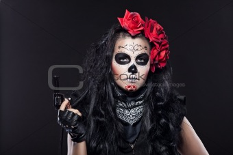 Serious woman in day of the dead mask portrait