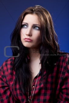 Young depressed girl in red shirt look with sad