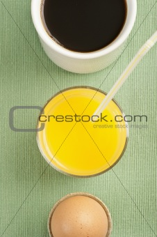 Breakfast with egg, orange juice and coffee