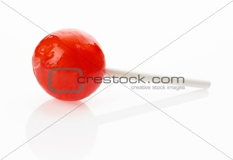 Red lollipop on white