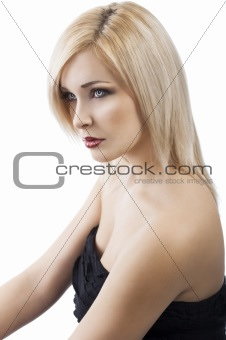 girl in elegant evening dress, she is turned of three quarters