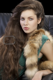 portrait of young elegant girl with fur