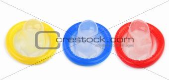 three colorful condoms
