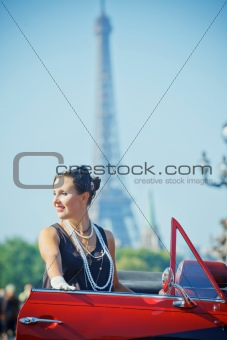 Happy smiling woman in a car. Romantic in Paris.