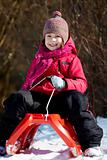 Girl on sledge