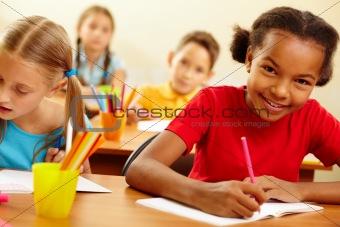 Classmates at drawing lesson